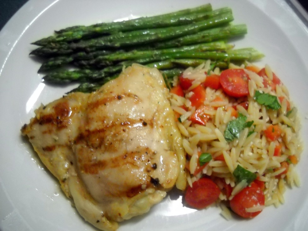 Grilled chicken breast with orzo and asparagus
