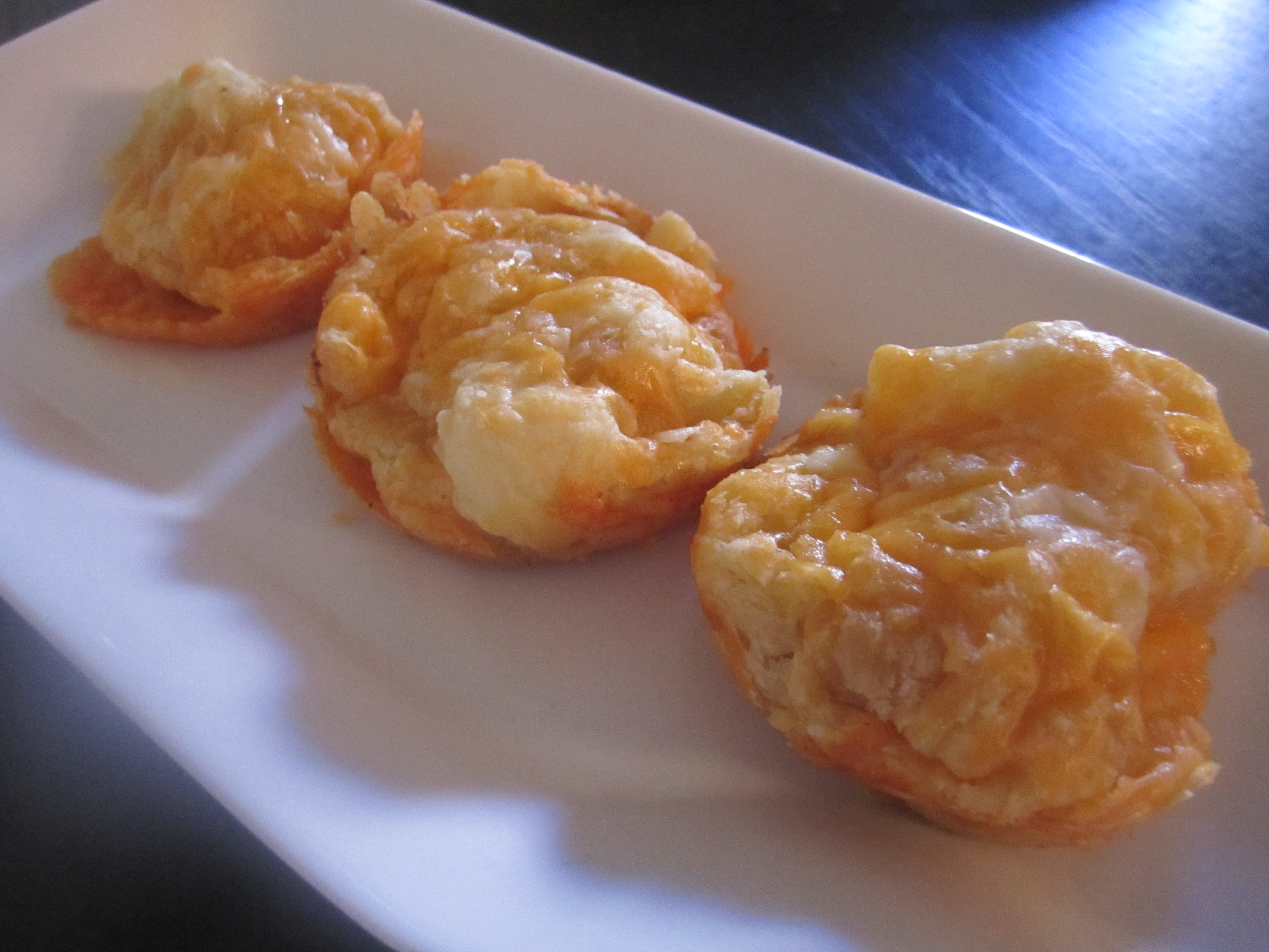 ... puff pastry, 1/2 (17.3-ounce) package 1/2 cup grated cheddar cheese